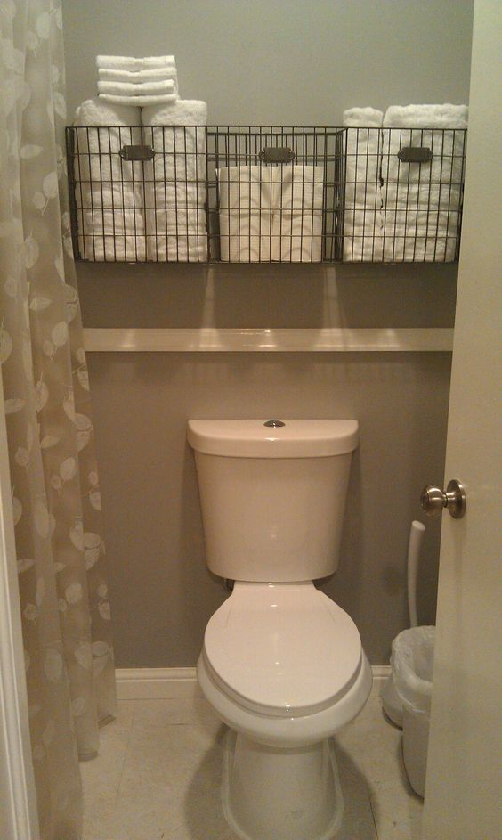 Very small bathroom storage idea - get more space in a tiny bathroom - baskets over toilet in small bathroom
