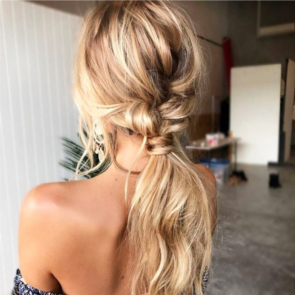 Easy ponytail hairstyles - love this twisted low ponytail idea
