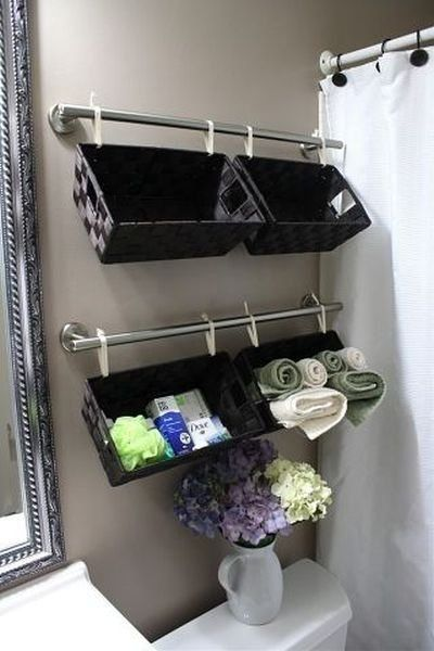 Isn't this CLEVER? And sure makes good use of the space over the toilet instead of using shelves.