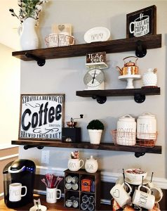 LOVE this home coffee bar area! The Rae Dunn canisters, industrial pipe wall shelves, the mugs - all of it!