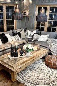 Gray farmhouse living room wall colors and decorating ideas - cozy grey small living room ideas on a budget in neutral colors with pops of color in the living room decor.